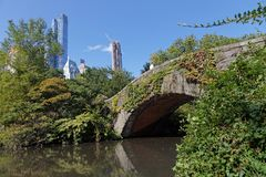 Gapstow Bridge in Central Park. NEW YORK CITY, USA, September 10, 2017 : Gapstow Bridge in Central Park. The simple fieldstone arch of Gapstow Bridge was built Royalty Free Stock Images