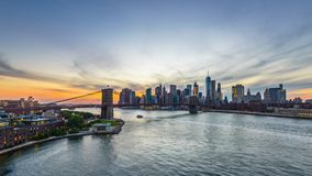 New York City. USA skyline time lapse over the East River with the Brooklyn Bridge and the lower Manhattan financial district stock video footage