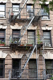 New York City Village apartment building with plants on the fire escape Royalty Free Stock Images