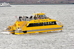 New York City Water Taxi. Yellow NYC Water Taxi in Action on the Hudson River Stock Image