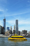 New York City Water Taxi with Freedom Tower and NYC skyline seen from Brooklyn Bridge Park Royalty Free Stock Photography