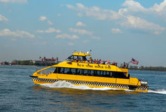 New York City Water Taxi in the front of Ellis Island Royalty Free Stock Photography