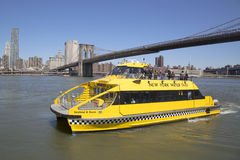New York City Water Taxi under Brooklyn Bridge Royalty Free Stock Photography