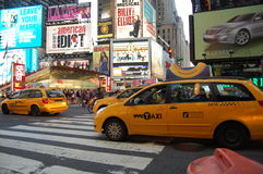 New York City yellow cabs in Times Square. Cabs and people crowd into New York City's Times Square Royalty Free Stock Photo