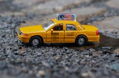 New York City yellow taxi cab toy car on street royalty free stock images