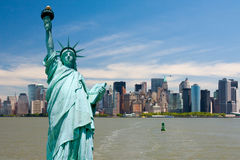 New York cityscape. New York city tourism conceptual, Statue of Liberty against Manhattan downtown Stock Photo