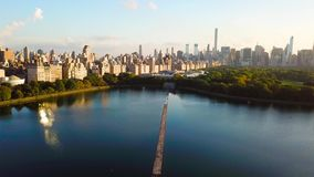 New York cityscape aerial view from Central park reservoir aerial. New York cityscape aerial view from the Central park reservoir aerial Frozen lake surface with stock footage