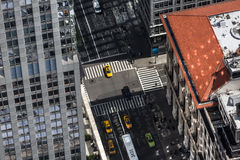New York cityscape birds eye view. NEW YORK, USA - Apr 30, 2016: Streets of Manhattan viewed from top of Empire State Building. Birds eye view Royalty Free Stock Photos