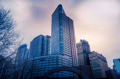 New York Cityscapes from Battery Park, Manhattan, New York, USA. New York Cityscapes, high-rise buildings, and dramatic sky. View from Battery Park, Manhattan royalty free stock photo