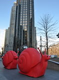NEW YORK - DECEMBBig Red Snails in Columbus Circle curated by owner and director of Galleria Ca' d'Oro, Gloria Porcel Stock Photography