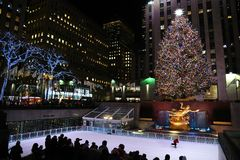 A brightly illuminated Rockefeller Plaza with a Christmas tree royalty free stock photography