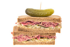 New York deli pastrami sandwich. A New York deli pastrami sandwich on rye bread.   This sandwich has slices of pastrami, grated Emmental cheese, gherkin and Royalty Free Stock Images