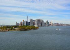 New York East River scenics. View across the East River near Brooklyn Harbor towards Governors Island and New York city skyline in the background; early Autumn Stock Photography