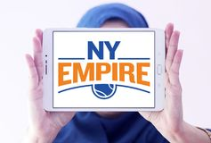 New York Empire tennis team logo. Logo of New York Empire tennis team on samsung tablet holded by arab muslim woman. The New York Empire is a World TeamTennis Royalty Free Stock Photography