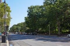 New York empty street near Central Park, green trees Royalty Free Stock Photos