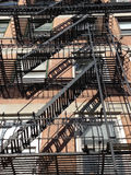 New York Escape. Typical New York City wrought iron fire escape, from below, only this one is very pretty Royalty Free Stock Photography