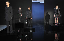 NEW YORK - FEBRUARY 09: Models pose at static presentation for the Porsche Collection F/W 2013 Royalty Free Stock Image