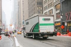 Enterprise rental truck in New York. New York February 12, 2019:Enterprise rental truck in New York. Enterprise Rent-A-Car is the largest rental car company in stock photography