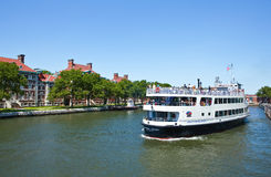 New York. A ferry boat with tourists near Ellis Island royalty free stock images