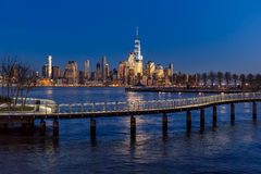 New York Financial District skyscrapers and Hudson River from Hoboken promenade. New York City Financial District skyscrapers at sunset and Hudson River from Royalty Free Stock Photos
