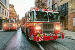 New York fire trucks on the streets. Fire engines driving on the streets of Manhattan, New York Royalty Free Stock Images