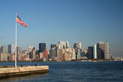 New York flag. Horizontal shot of Flag of United States in Ellis Island with New York skyline in background Stock Photo