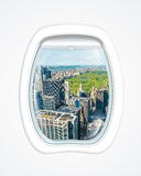 New York flight. Aerial view of New York skyline and Central Park on board of a plane through the porthole window. copy space Royalty Free Stock Image