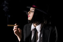 New York Gangster. Attractive brunette dressed as a new york gangster with black background Royalty Free Stock Photos
