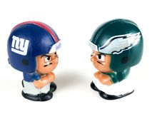 Giants and Eagles Li`l Teammates figures. New York Giants and Eagles Li`l Teammates figures on a white backdrop Stock Photo
