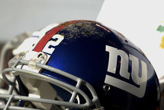 New York Giants Football Helmet. New York Giants blue and white football helmet sitting on the bench during a time out stock photo