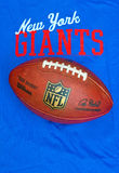 New York Giants. ZAGREB , CROATIA - NOVEMBER 17, 2015 :  NFL New York Giants club equipment with NFL official ball, product shot Stock Photos
