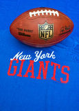 New York Giants. ZAGREB , CROATIA - NOVEMBER 17, 2015 :  NFL New York Giants club equipment with NFL official ball, product shot Stock Image