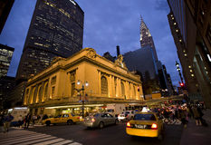 New York , Grand Central. New York city ,42nd street Grand Central Terminal , Chrysler building , taxi and cars going by. sunset stock image