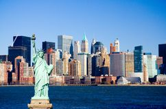 New York Harbor. Statue of Liberty overlooking Manhattan and New York Harbor Royalty Free Stock Image