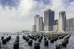 New York Harbor and Manhattan Skyline, with Pier Pilings. Royalty Free Stock Photography