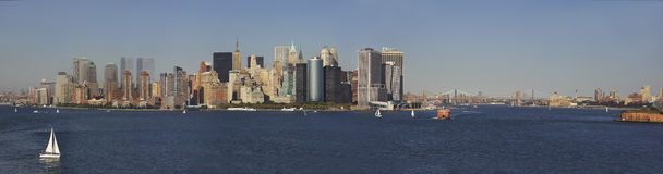 New York Harbor Panorama. Panorama of New York City harbor showing New York City Skyline and Brooklyn Bridge Stock Photos