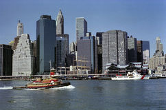 Pier Seventeen and Harbor, New York USA. Manhattans Pier Seventeen and East River waterfront, Manhattan financial district. Tug boat Janice Ann Reinauer, US royalty free stock photo