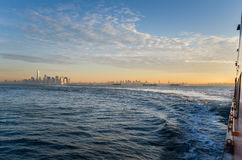 New York Harbour at Dawn with Manhattan in Background Royalty Free Stock Photo