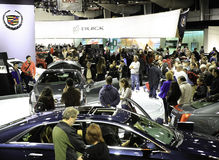 People Attending the New York International Auto Show. The New York International Auto Show is an annual auto show held in New York City in late March or early Stock Photos