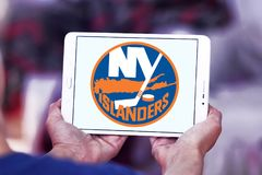 New York Islanders ice hockey team logo. Logo of New York Islanders ice hockey team on samsung tablet. The New York Islanders are a professional ice hockey team royalty free stock images