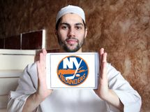 New York Islanders ice hockey team logo. Logo of New York Islanders ice hockey team on samsung tablet holded by arab muslim man. The New York Islanders are a stock photography