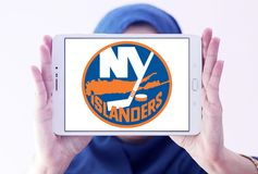 New York Islanders ice hockey team logo. Logo of New York Islanders ice hockey team on samsung tablet holded by arab muslim woman. The New York Islanders are a royalty free stock photography