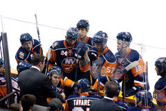 New York Islanders Players. The bench of the New York Islanders during pre-season NHL game royalty free stock photo