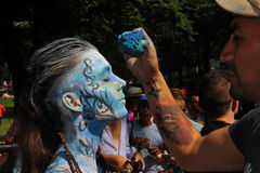 NEW YORK - JULY 26: Nude models, artists take to New York City streets during first official Body Painting Event. Featuring artist Andy Golub on July 26, 2014 Royalty Free Stock Image