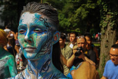 NEW YORK - JULY 26: Nude models, artists take to New York City streets during first official Body Painting Event. Featuring artist Andy Golub on July 26, 2014 Royalty Free Stock Photos
