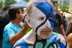 NEW YORK - JULY 26: Nude models, artists take to New York City streets during first official Body Painting Event. Featuring artist Andy Golub on July 26, 2014 Royalty Free Stock Images