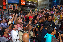 NEW YORK - JULY 26: Photographers, artists and crowd making photos at Times Square Royalty Free Stock Photos