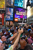 NEW YORK - JULY 26: Photographers, artists and crowd making photos at Times Square during first official Body Painting Event Stock Photos