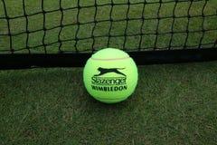 Slazenger Wimbledon Tennis Ball on grass tennis court. NEW YORK - JULY 2, 2019: Slazenger Wimbledon Tennis Ball on grass tennis court. Slazenger Wimbledon Tennis royalty free stock images