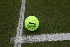 Slazenger Wimbledon Tennis Ball on grass tennis court. NEW YORK - JULY 2, 2019: Slazenger Wimbledon Tennis Ball on grass tennis court. Slazenger Wimbledon Tennis stock photos